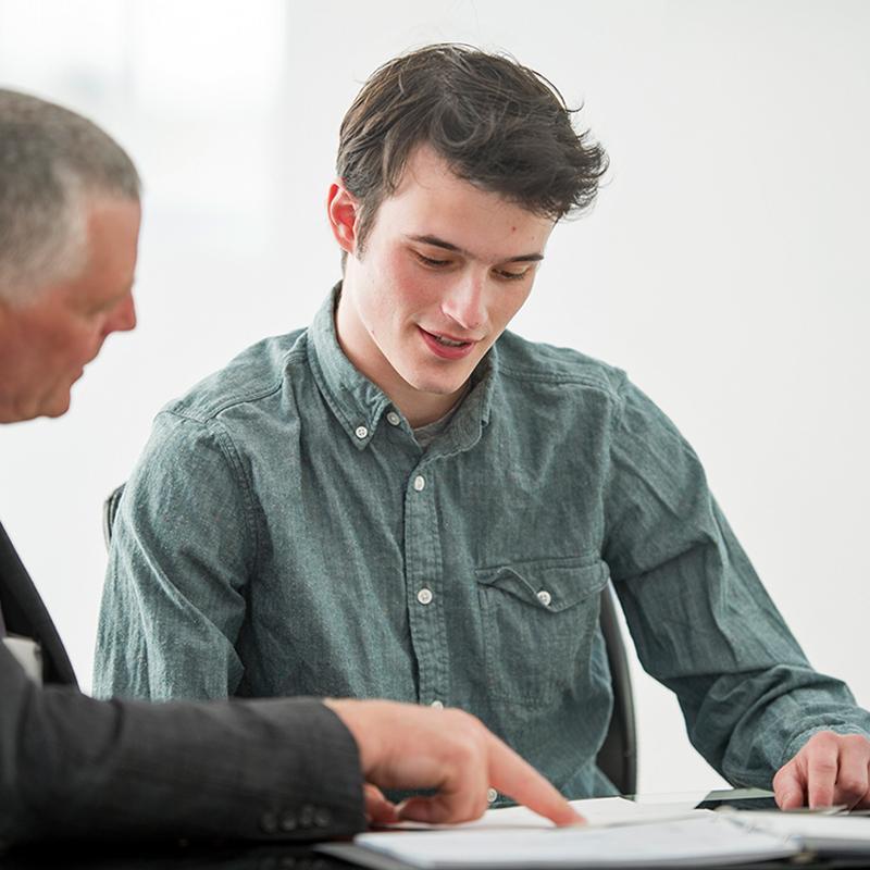 BRITA career young man old sitting desk talking
