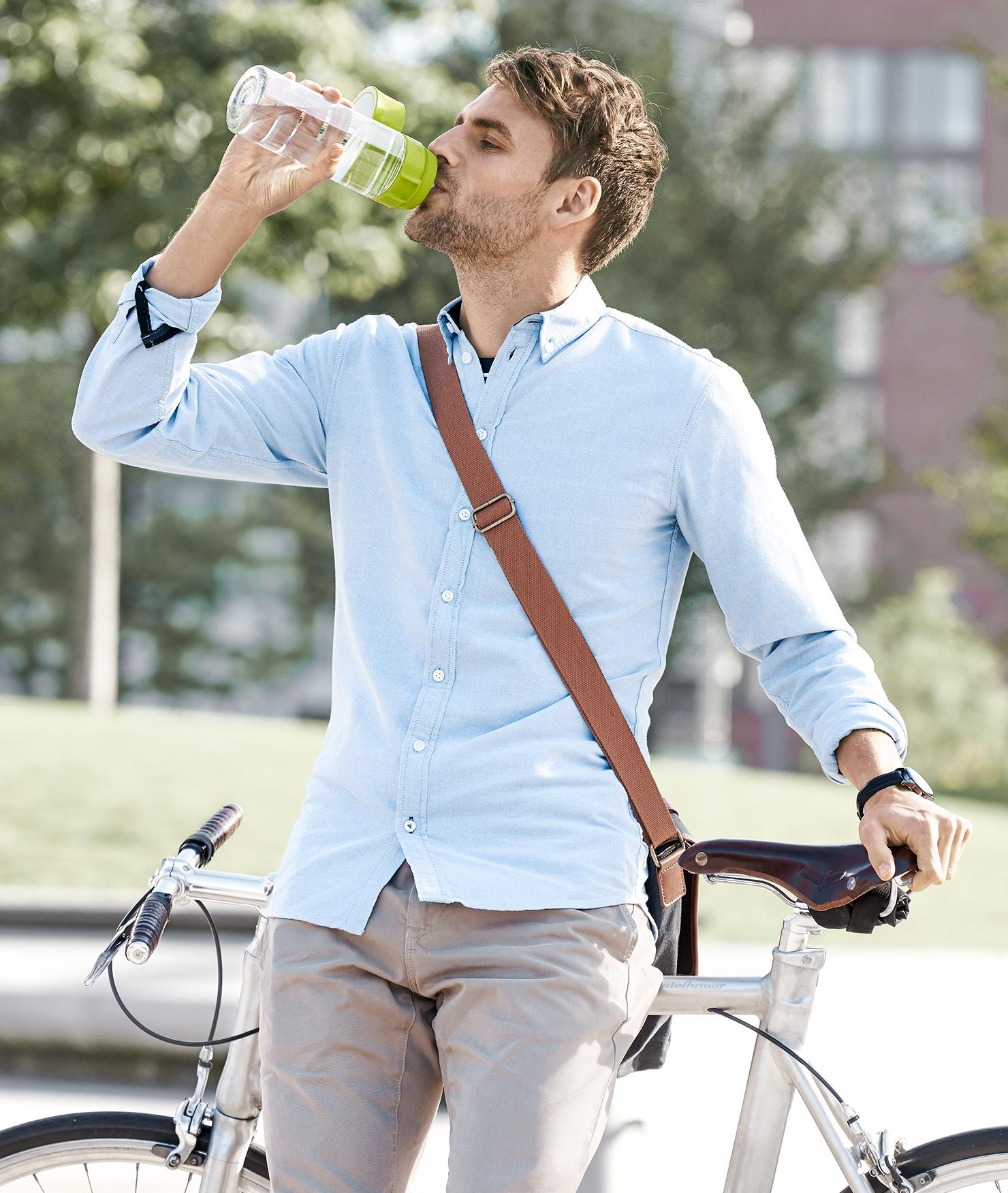 BRITA healthier planet man on bike drinking water