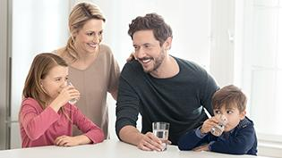 Family smiling in kitchen
