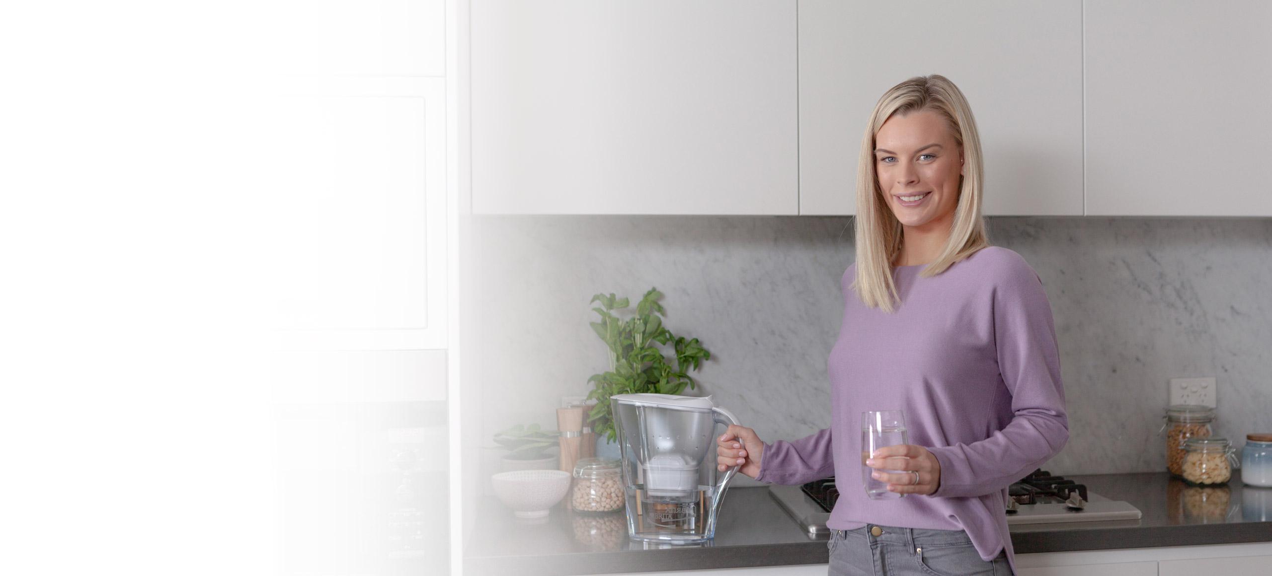 Girl in purple holding BRITA jug