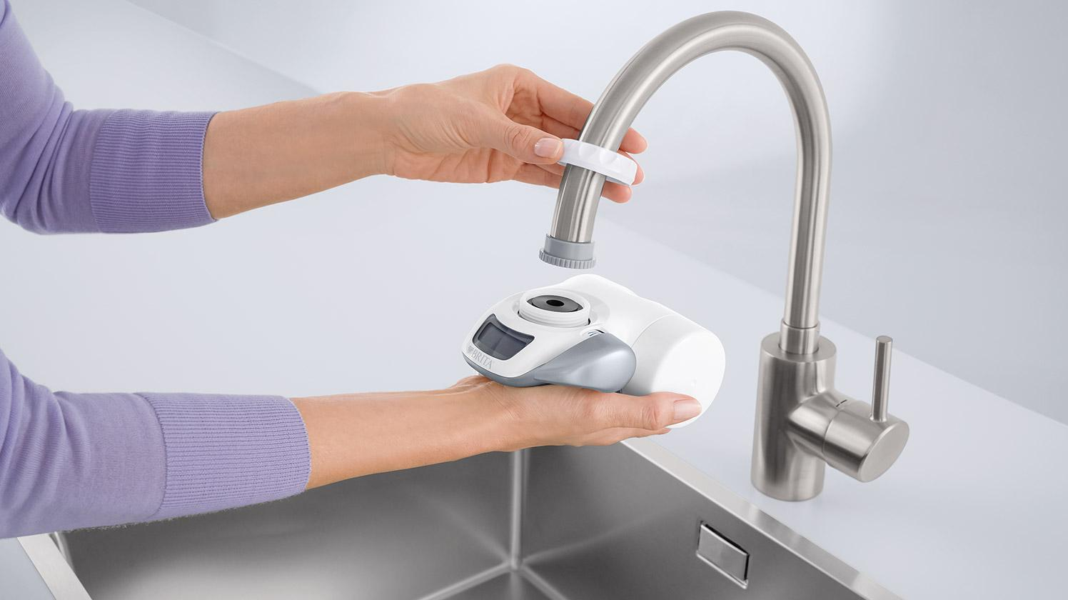 BRITA On Tap water filter adapter on faucet.