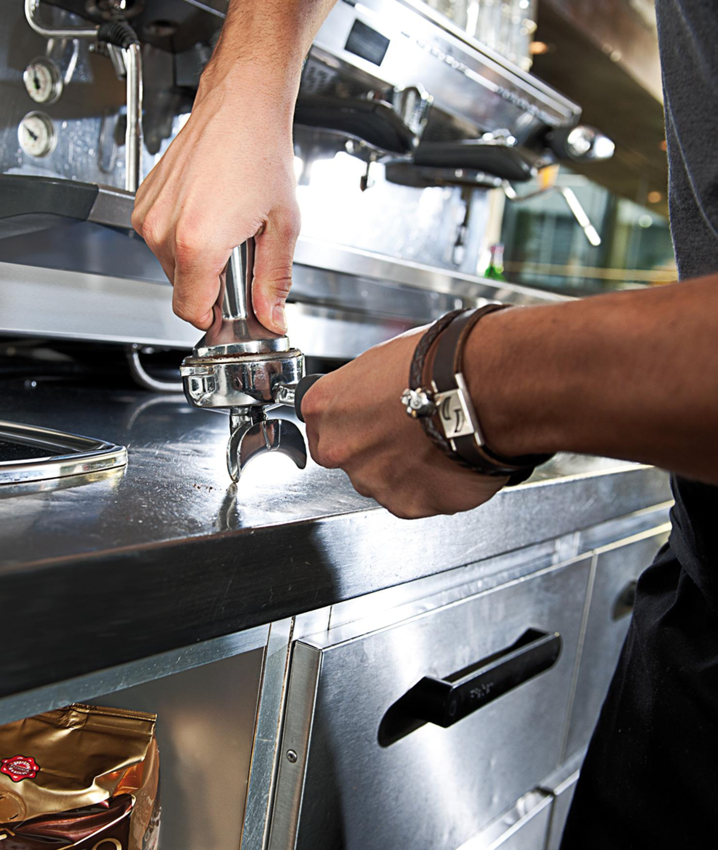 Espresso being served from a coffee machine