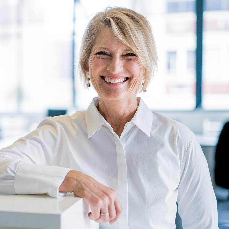 BRITA career woman smiling in office