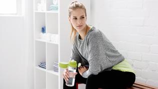 Woman sitting in locker room
