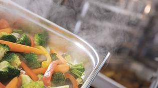Steamed food in professional kitchen