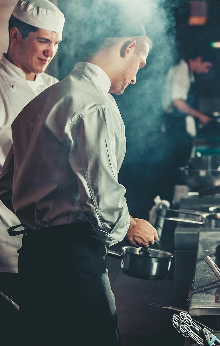 Professional chefs in a busy kitchen