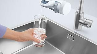 Filling Glas of Water with On Tap.
