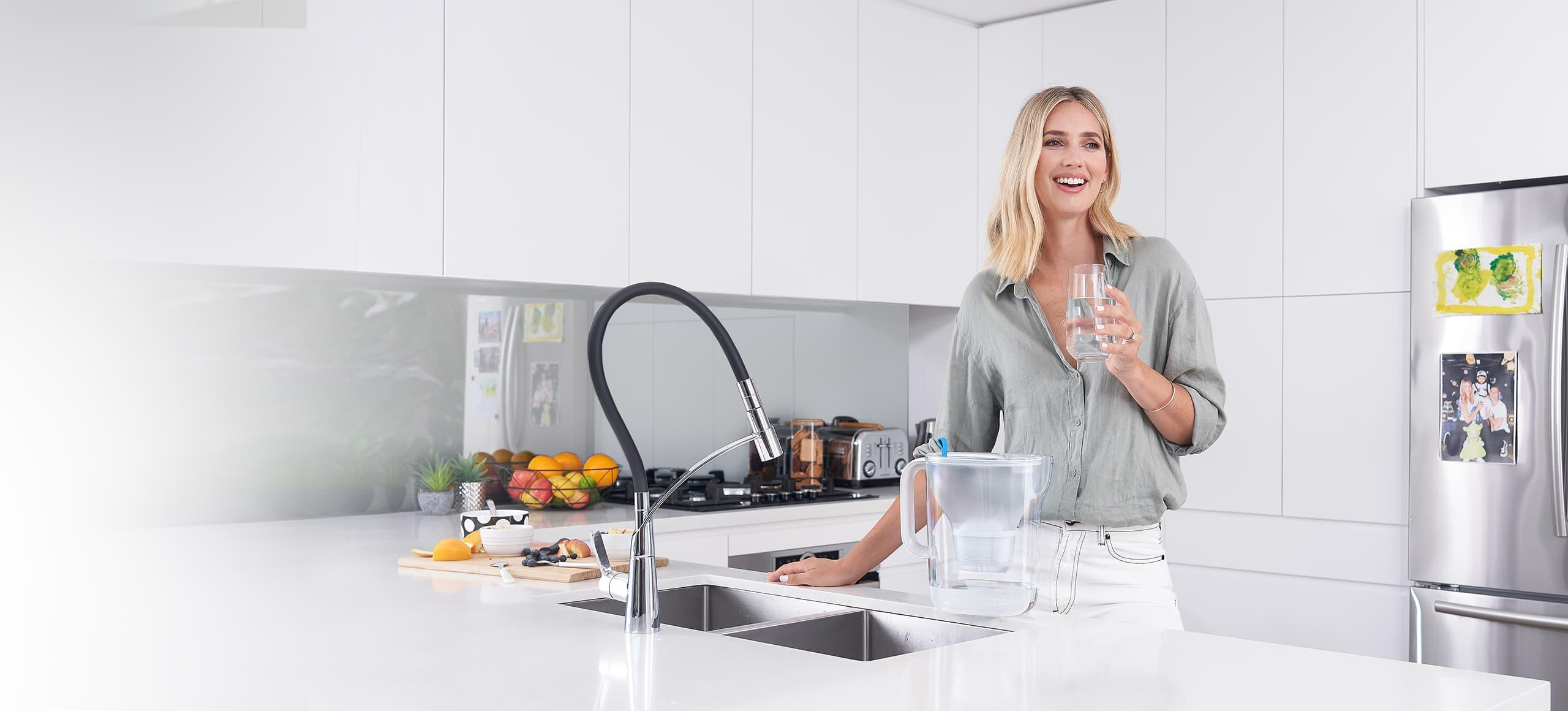 Woman with water filter jug
