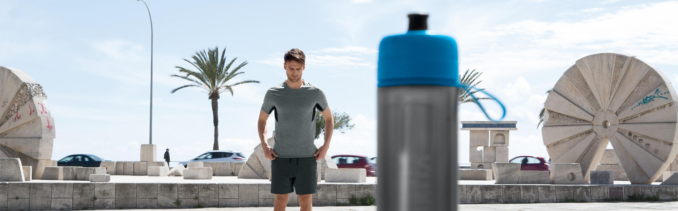 Man in background with BRITA Active blue