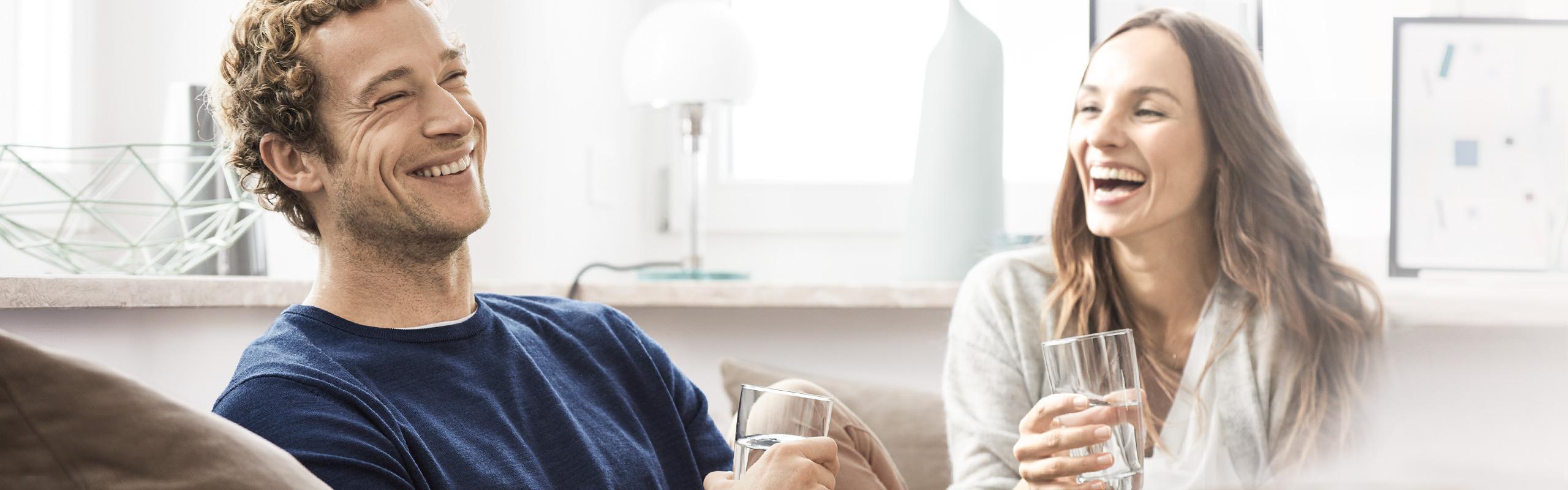 Happy couple in living room