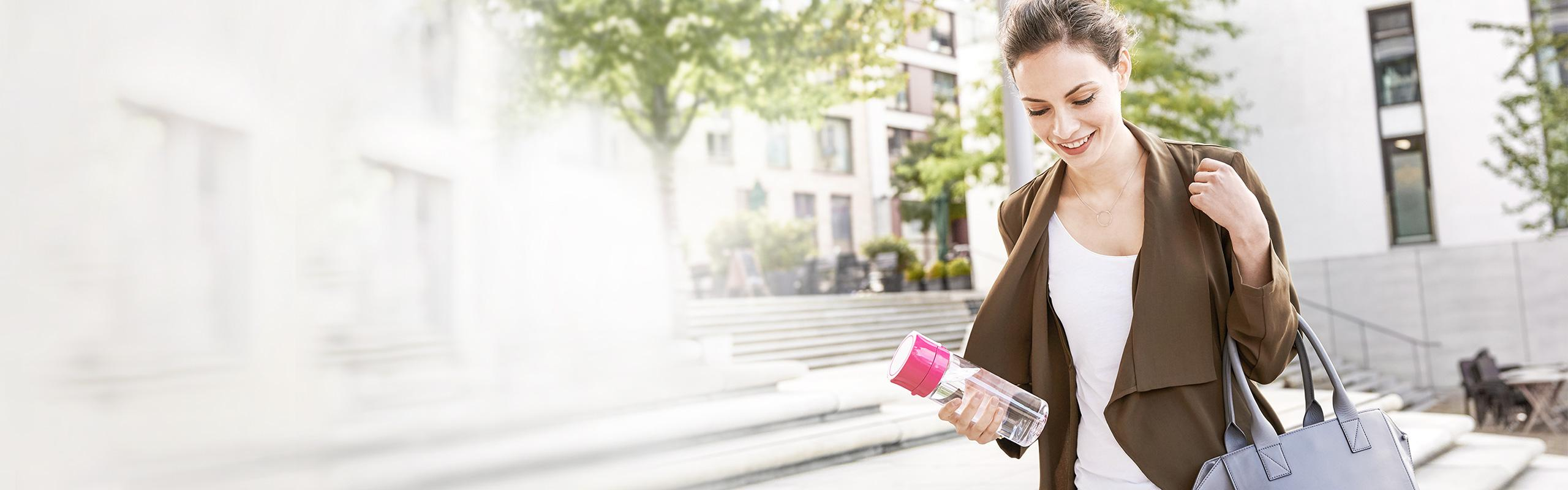 Woman with water filter bottle