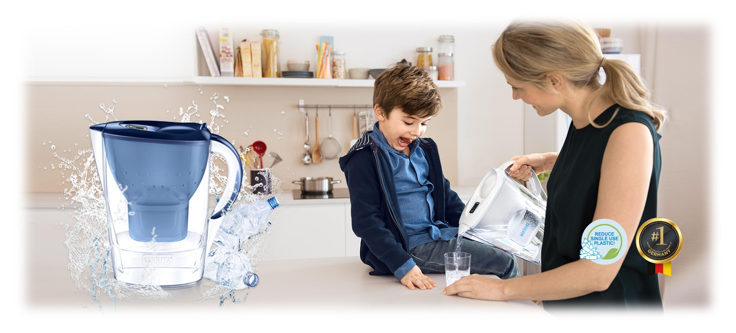 BRITA filter jug and woman with child in kitchen